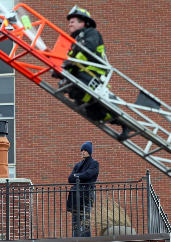 Tom Brady watches as a 9 alarm fire rips through a home 2 doors down from his home at the 300 block of Beacon St. http://t.co/paNrNKKS2L