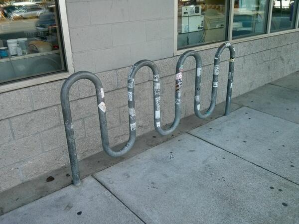 NEW LAW: bike racks must be installed by someone who has used one at least once in the last 10 years. http://t.co/MDeCt151Hs