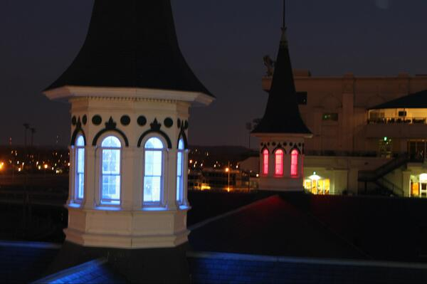 The game 24 hours away, quiet beneath @ChurchilDowns' #TwinSpires - one blue for Kentucky, one red for Louisville http://t.co/ZdHJP7kZRD