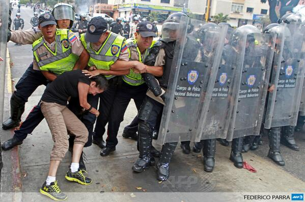 An anti-government activist clashes with riot police during a protest in Caracas, Venezuela http://t.co/NGLajmPRGh