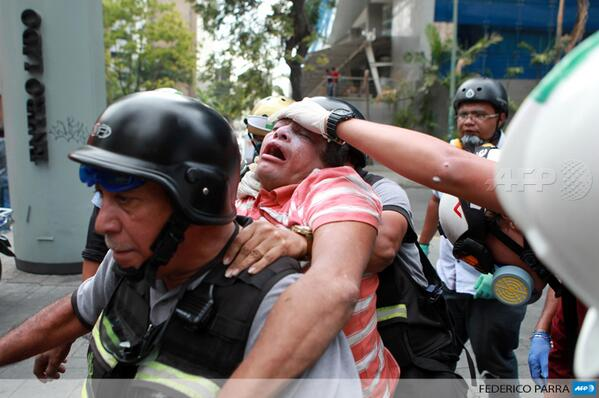 Firemen help an anti-government demonstrator during a protest in Caracas, Venezuela http://t.co/87P19VXEZR