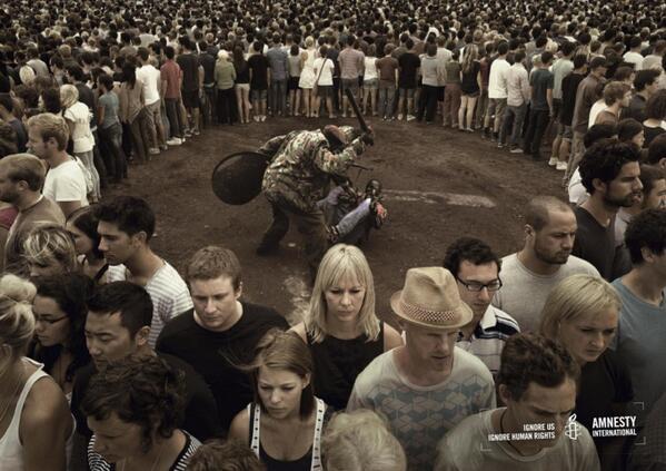 """政治海报的设计中,我相当欣赏大赦国际出的几组。下面这张的主题是""""默许就是纵容"""" http://t.co/sNA48heqPt"""