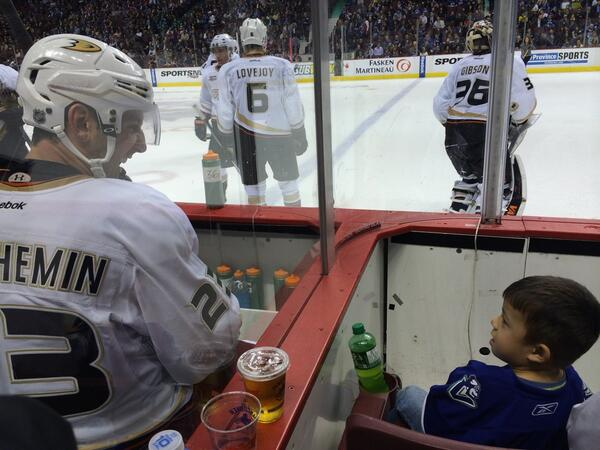 Beauchemin just gave this little guy a puck. Hockey players are good people. @NHL @AnaheimDucks @VanCanucks http://t.co/C3dOqN02tT