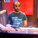 Photo of the man in court who opens the cages. Check out the slogan in english #AJTrial http://t.co/D5ucB7UpQr