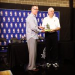 R.C. Buford and Coach Pop pose with the Red Auerbach Trophy. #GoSpursGo http://t.co/A0TNjQL3Vb