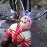 """@MailOnline: Image of a toddler being held hostage at gunpoint emerges from Syria http://t.co/TxiQujGjt6 http://t.co/AbYS6vbObD"