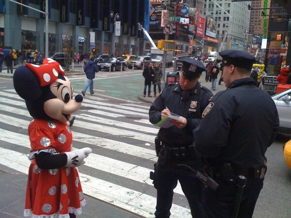 A picture I took in Times Square, Feb 2010 of Minnie Mouse getting arrested. #myNYPD http://t.co/7kbuntxBGM