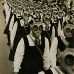 School girls in gas masks. WWII. http://t.co/PnaRwQAZph