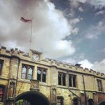 The English flag flies above Lincoln Guildhall. #HappyStGeorgesDay http://t.co/BBAzxwUEbz http://t.co/tercLHPD6U