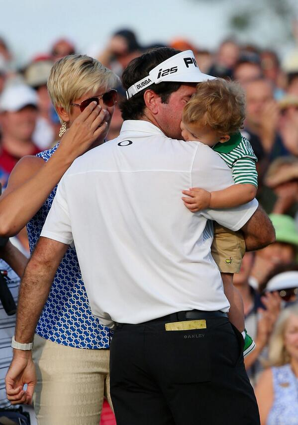 .@bubbawatson celebrates w/his family on the 18th green after winning his 2nd #Masters. Help us congratulate him! http://t.co/dz1T4cj1vm