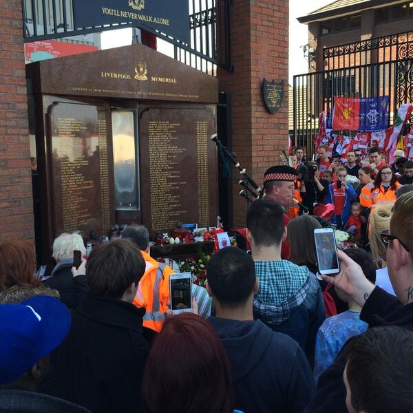 A bagpipe player at the Hillsborough memorial on Anfield Road ahead of the memorial service http://t.co/k8qRVErc2y