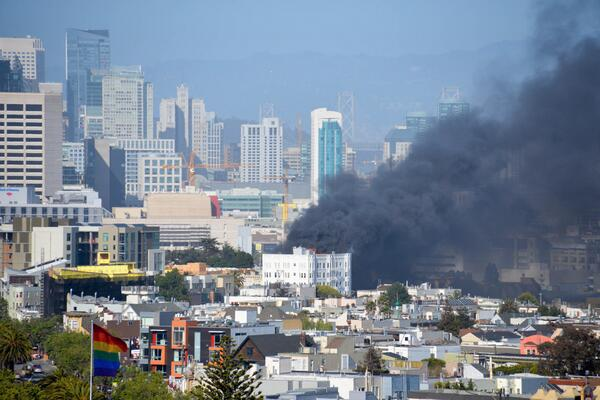 Huge apartment fire. Looks like 87 Dolores -- the big white confection: http://t.co/pb3GUYHOYD