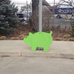 Have you seen these green pigs? Its an ad for a real estate co. Details: http://t.co/zW9O8yfC3D via @denverpost http://t.co/pXReMftn5o