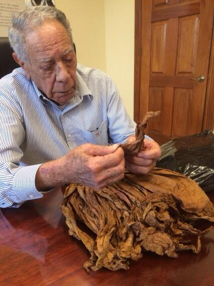 A master at work: Jose Orlando Padron inspecting a new crop of Nicaraguan cigar tobacco. http://t.co/Ytx9PNmEI9