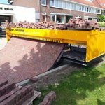 A Tiger-Stone road laying machine automatically sorts and lays bricks. http://t.co/LnwxOJE0ui