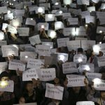 PHOTO via Reuters: Students hold signs with messages of hope for their missing friends who were on the S.Korea ferry http://t.co/OC1QuiXIgT