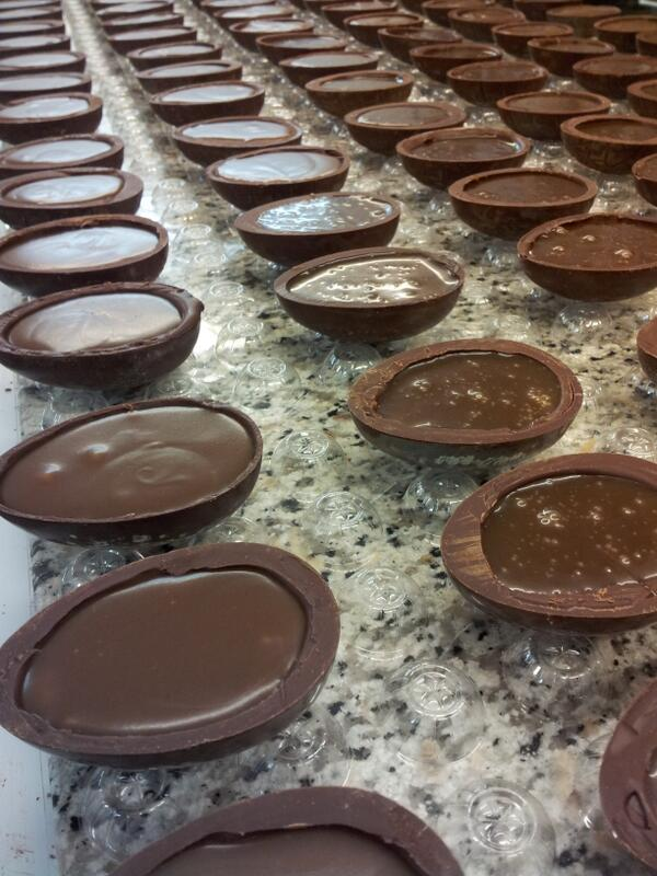 my amazing teams making more sea salted caramel filled eggs for tomorrow morning. #saltedcaramel #easterchoc http://t.co/GeEPdXoRFG