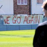 PHOTO: Brendan Rodgers and Steven Gerrard watch on as fans unveil a We Go Again banner during training http://t.co/I2OnC2stDk