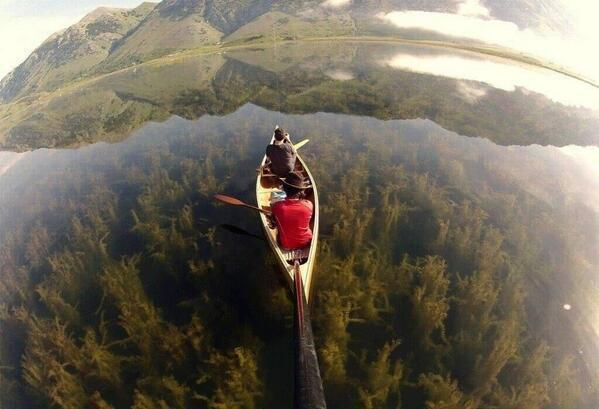 Canoeing in a crystal clear lake, Italy: http://t.co/wS0xGMn7bx
