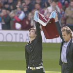 Younger brother Taylor Tombides and father Jim place Dylans shirt at the centre circle before #WHUCRY #foxfootball http://t.co/vlKnIgauFt