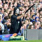 RT @BBCSporf: QUALITY: An Everton fan has dressed up as The Grim Reaper & is stood directly behind David Moyes. http://t.co/XIJJvARfDV