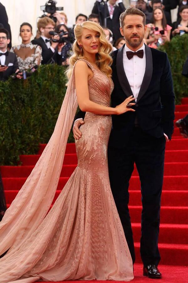 Blake Lively & Husband Ryan Reynolds looked dazzling at the #metgala. http://t.co/ejSghB8ADk