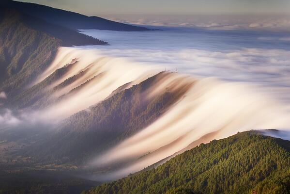 A Waterfall of Clouds on the Canary Islands photographed by Dominic Dähncke. http://t.co/Fd3pKwIm5Z