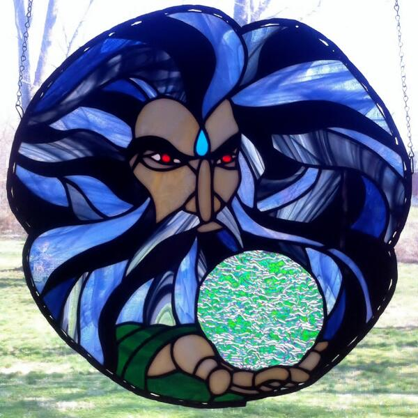 ...finished another wizard. He has a #dichroic crystal ball and red jeweled eyes. #stainedglass #art #GameOfThrones http://t.co/B3DPYrBgx5