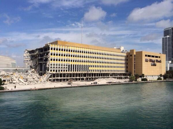 Wow! 100-ft chunk of old @MiamiHerald bldg just got knocked down. Photo by @WalterMichot: #miami @romenesko http://t.co/IP69xQUewt