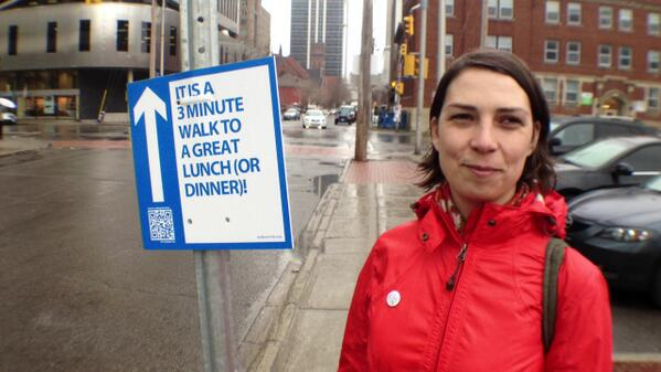 Here's @modalmom w/ one of her guerilla Walk Your City signs #ottbike #ottwalk @WalkYourCity http://t.co/wE14RbeK9q