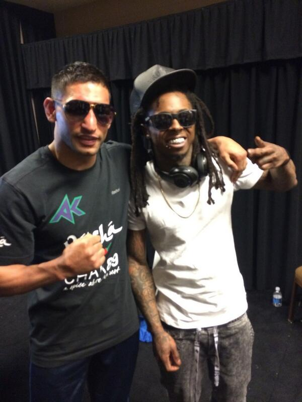 Crazy scenes in the changing room with @LilTunechi coming over huge @AmirKingKhan fan http://t.co/kWu1aweOuc