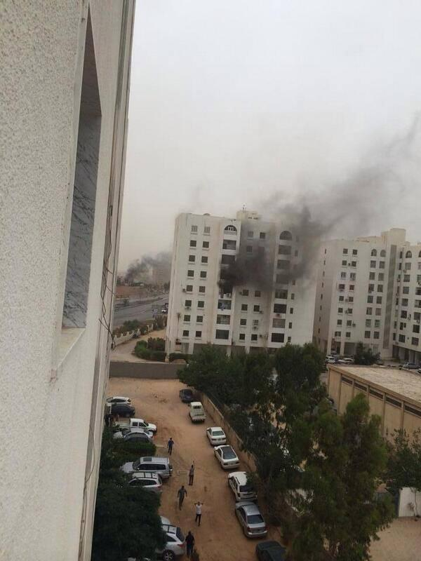 """@MuhannedK: RPG HIT APARTMENT IN BUILDINGS RIGHT ACROSS THE ROAD FROM US http://t.co/hrDxXovwPT"" #tripoli #libya"