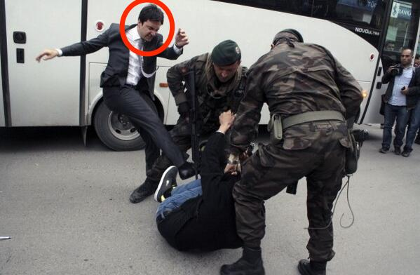 The man kicking this protester is an adviser to Turkey's prime minister  http://t.co/Y8lx2j0Bby http://t.co/Woa6Yi7JL1