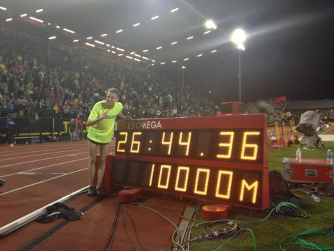 Galen Rupp pictured with the clock after breaking the American Record at Hayward Field http://t.co/ROq7VhYVmW