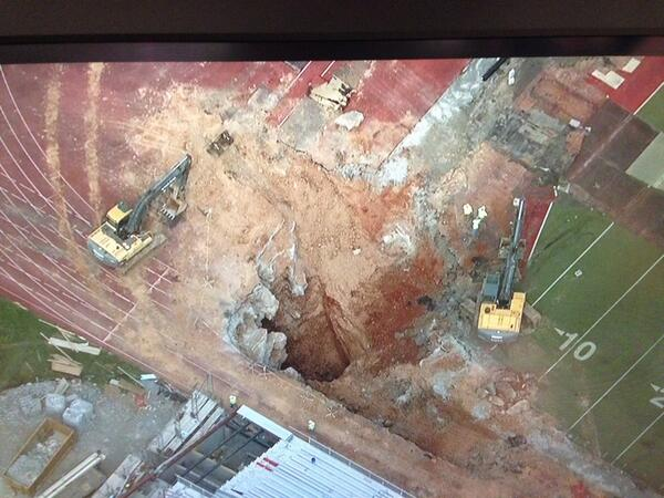 Large sinkhole at APSU football field. Sky 5 over the scene now. Details at 4. #APSUSinkhole http://t.co/nyFXnYkLPy