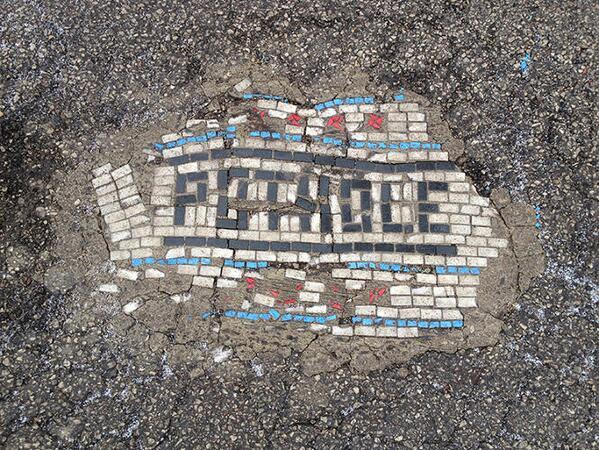 Chicago artist Jim Bachor is filling potholes in with mosaics. http://t.co/rL18XTLCLt http://t.co/T0xNSq9Yns