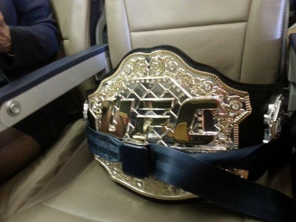 Safety first! @TJDillashaw making sure the @ufc title is buckled in & comfortable when traveling. #TeamAlphaMale #swa http://t.co/LnodNNvrwJ