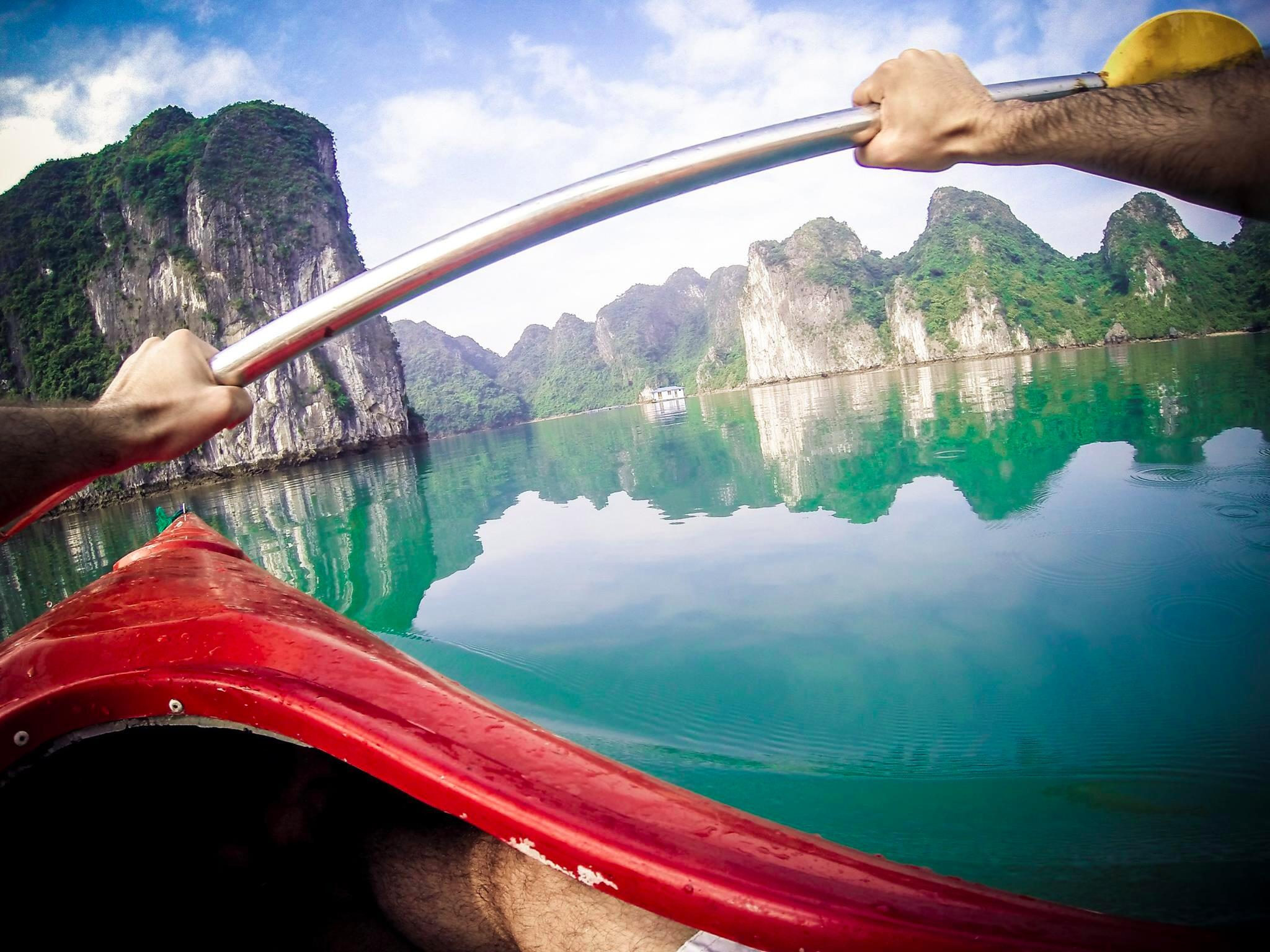 Photo of the Day! @MicheleArdu paddles through Ha Long Bay in Vietnam. http://t.co/5fKPtOhC1Q
