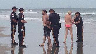 Couple caught having sex on the beach
