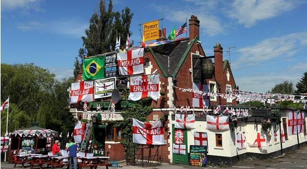 Flagtastic Robin Hood pub, Jarrow. How are you getting in the #WorldCup mood? Send @bbcsport your pix #myworldcupseat http://t.co/rUmBFnEI7k