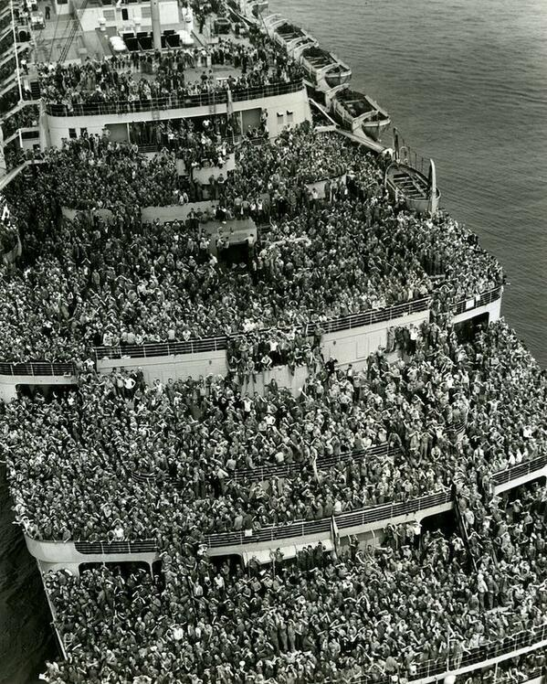 "The liner ""Queen Elizabeth"" bringing American troops into NY Harbor at the end of WWII, 1945 http://t.co/72tiUcDZ6V"