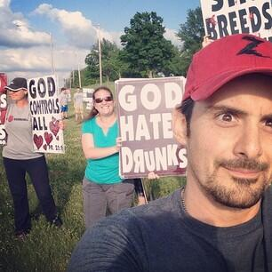 Westboro Baptist Selfie!! Or west-Burro(ass) selfie. Hopefully they can hear the show out here. We'll play loud. http://t.co/OrMhJjD8NE