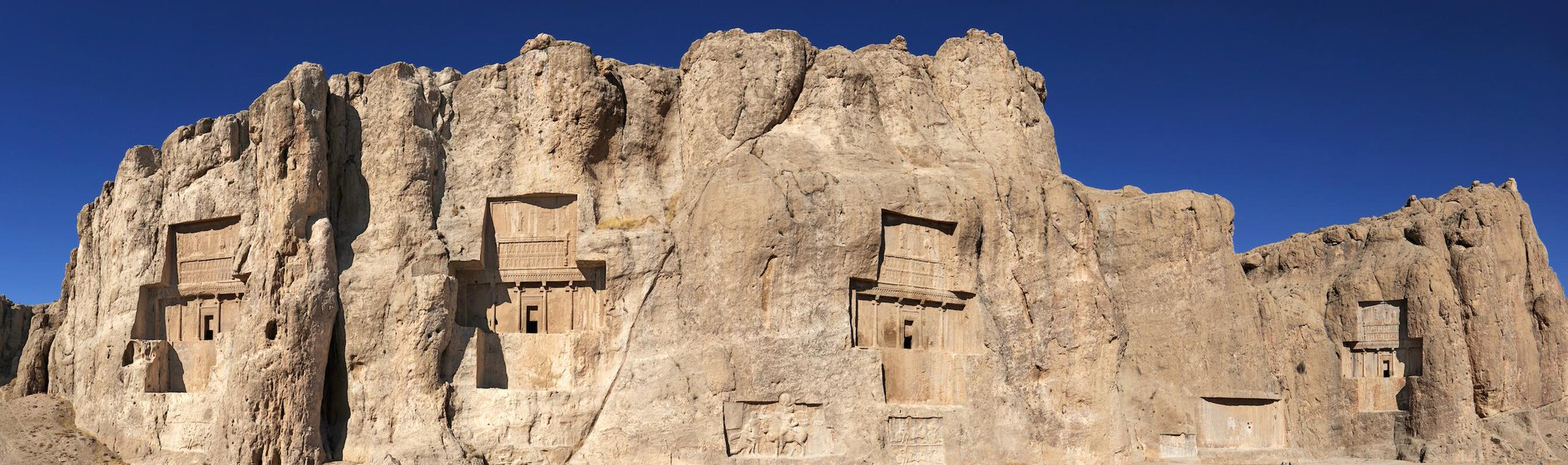 Naqsh-e Rostam, a Persian necropolis near Persepolis, Iran. Tombs of Darius and Xerxes carved in the cliff side. http://t.co/Fwv32TtxR1