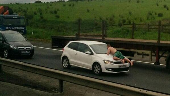 Man in tartan boxer shorts caused disruption after running across M8 and climbing on cars http://t.co/B7ZbmuV5uC http://t.co/Pzuwy14ZhB