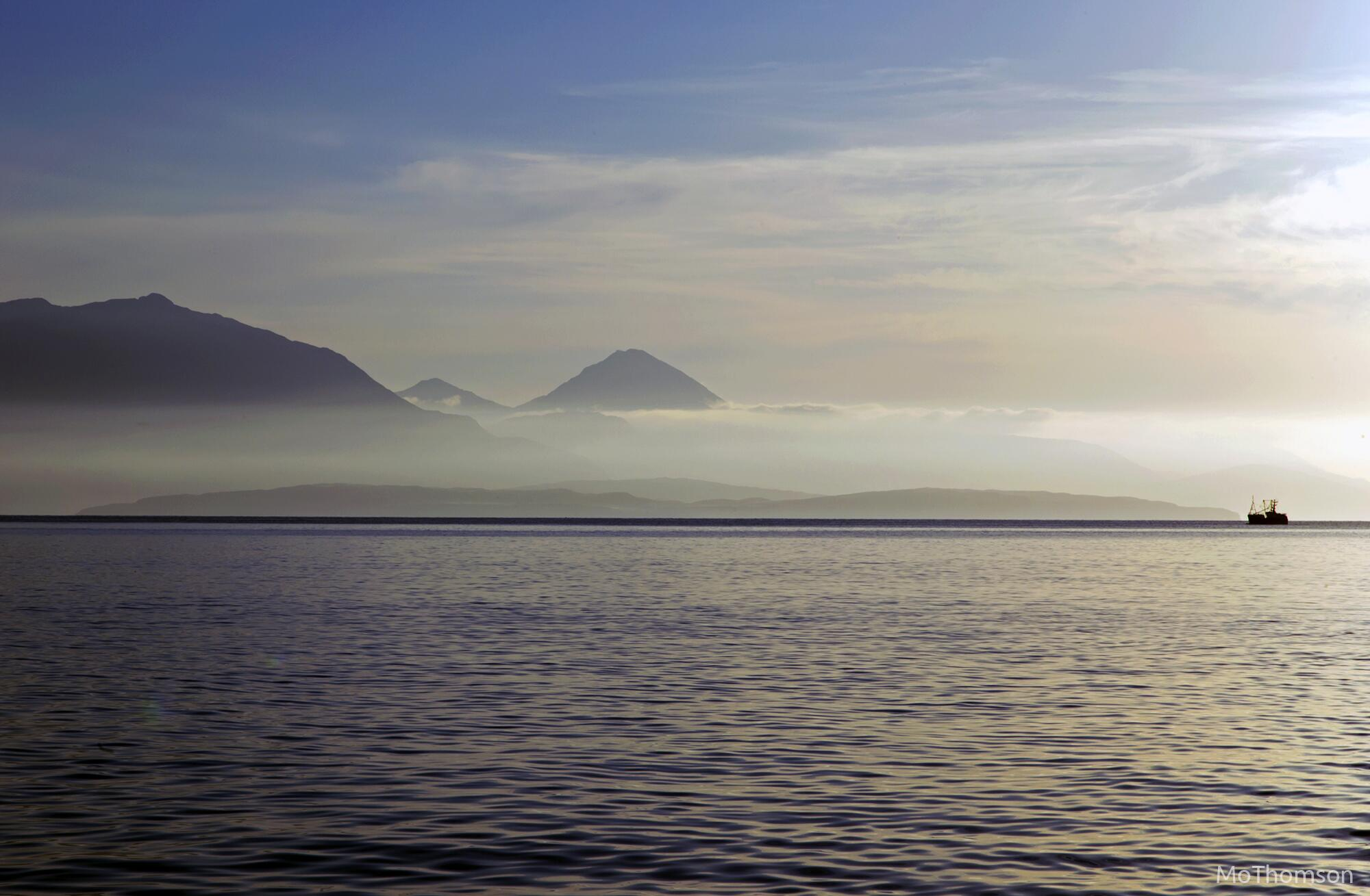 RT @MoThomson: A wee fishing boat off the coast of a misty Skye, just after sunrise http://t.co/HqGIOt4FdV