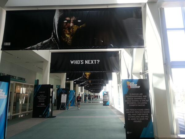 """Who's next?"" asks the MK signs at #E3. Er, looking at whose face is on 'em, Scorpion's next. Every. Bleeding. Time. http://t.co/pH3U66or1M"