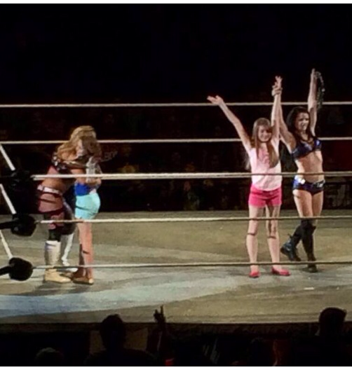 This pic of Warrior's daughters in ring w/@RealPaigeWWE & @NatbyNature last night is awesome http://t.co/KZ1taIAClY