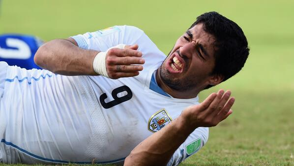 BREAKING: FIFA charges Uruguay's Luis Suarez with biting. He faces a maximum two-year ban. http://t.co/uk2rM6kex8 http://t.co/gg6XaufboI