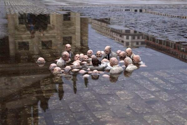 """Here, via @RachelHarger, is a great piece by Issac Cordal in Berlin called """"Politicians discussing global warming."""" http://t.co/qxF2jU0I6I"""