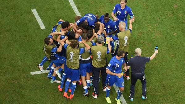 Italian players celebrate opener [via FIFA]